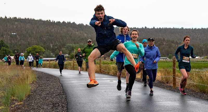 LON AUSTIN/CENTRAL OREGONIAN - Runners leave the starting line of the first annual Wetlands Webfoot Waddle, which was held at the Crooked River Wetlands Complex on Saturday.