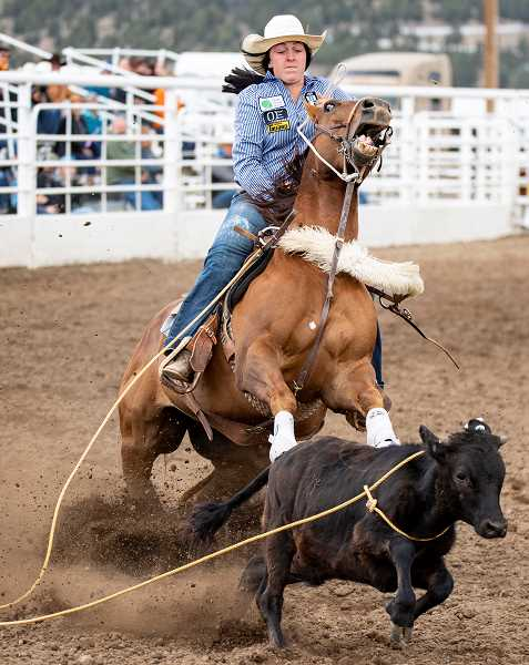 LON AUSTIN/CENTRAL OREGONIAN -  Hope Luttrell finishes her breakaway roping run on Saturday. Luttrell posted a time of 6.06 seconds on the run to finish seventh in the go round. Luttrell placed eighth in the final standings.