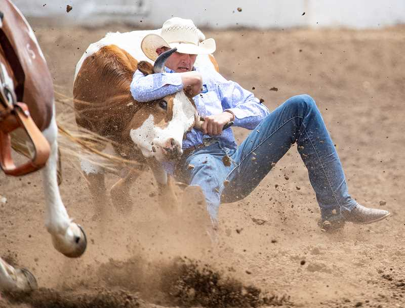 LON AUSTIN/CENTRAL OREGONIAN - Jaxson Rhoden finishes his steer wrestling run on Saturday. Rhoden posted a time of 12.43 to finish seventh in the go round. Rhoden was also seventh in the final standings of the event.