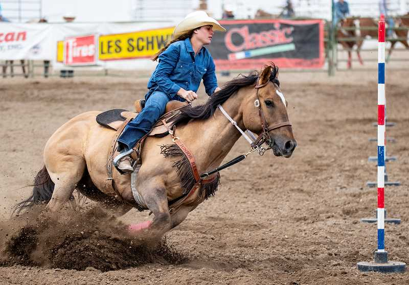 LON AUSTIN/CENTRAL OREGONIAN - Kennedy Buckner makes her first turn in pole bending on Saturday during the final go round of the Oregon High School Rodeo Association State Finals. Buckner won all three go rounds in the event and won the championship. Buckner also qualified for nationals in goat tying.