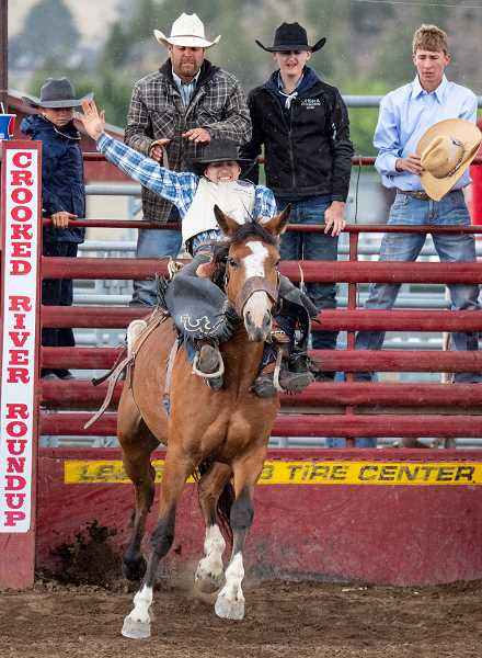 LON AUSTIN/CENTRAL OREGONIAN - Chase Buchanan scores 68 points Saturday to win the short go round in saddle bronc riding. Buchanan also won the state championship in the event.