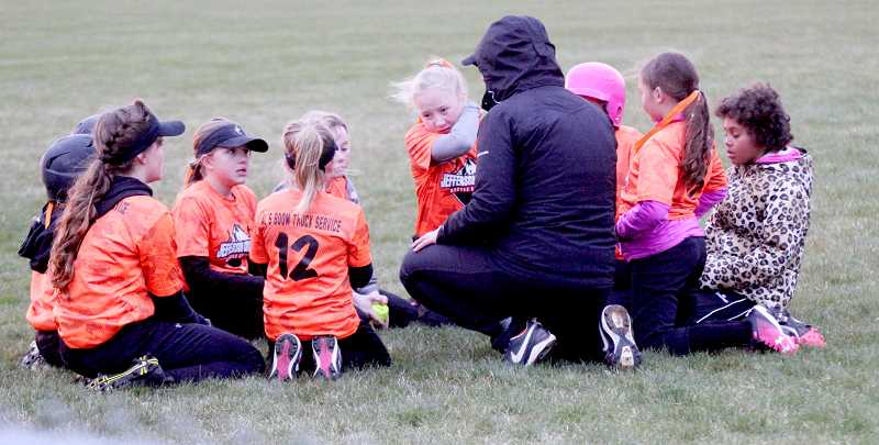 STEELE HAUGEN - A Culver Jefferson County softball team is meeting after a game.