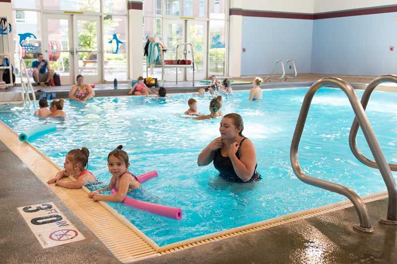 STAFF PHOTO: CHRISTOPHER OERTELL - A preschool-level lesson is taught at the Forest Grove Aquatic Center this week. The indoor pool allows for all-season lessons and free swims.