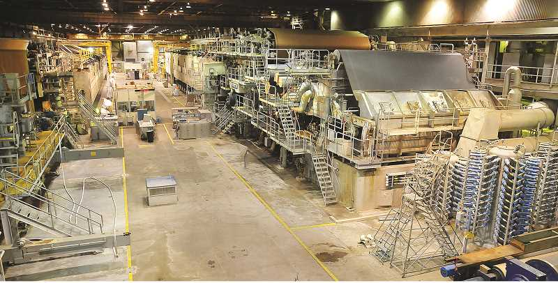 GRAPHIC FILE PHOTO - Conditions set by Westrock for the sale of its Newberg mill require that the buyer destroy its two remaining paper machines before the metal is sold for scrap.