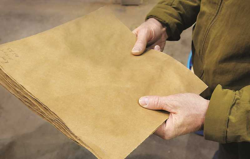 GRAPHIC FILE PHOTO - A few months before selling to Westrock, SP Fiber Tech converted one of its newsprint machines to produce brown kraft paper (above), used in paper bags and cardboard products. Scrap metal dealers are eyeing the mill for the millions of pounds of steel and aluminum (below) at the Wynooski Street site.