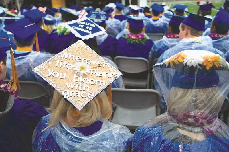 GARY ALLEN - Mortar boards were adorned with myriad message, props and other paraphernalia at Friday's ceremony.