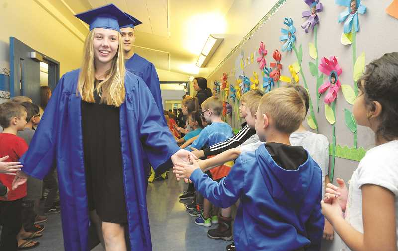 GARY ALLEN - On Thursday, soon-to-be grads toured Newberg elementary and middle schools during the Grad Walk.