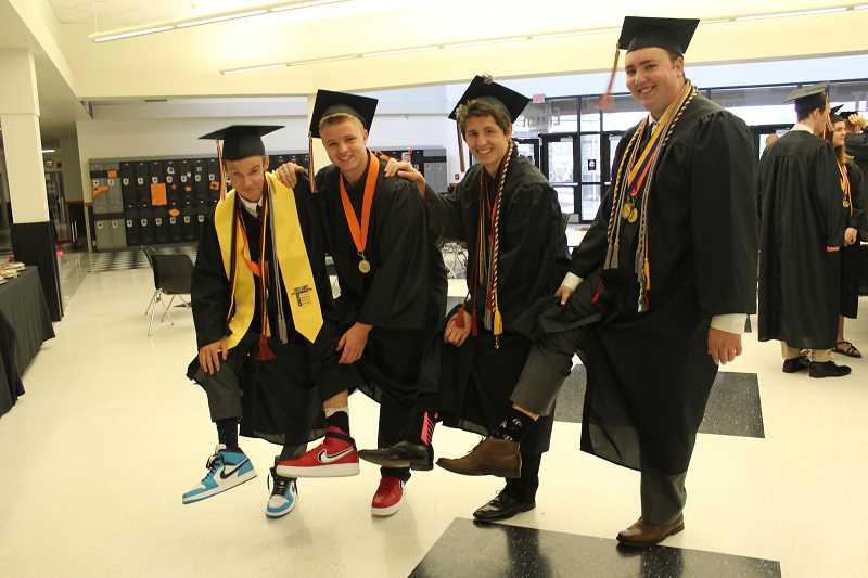 PIONEER PHOTO: KRISTEN WOHLERS - Some of Molalla's graduating guys show off their socks and kicks before graduation on Saturday, June 9.