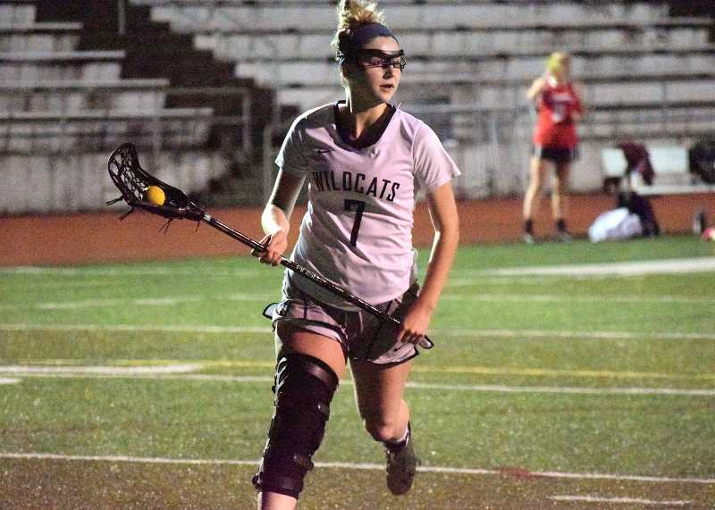 SPOKESMAN FILE PHOTO: TANNER RUSS - Senior MacKenzie Welberg earned second team all-state honors for her work as a middie. In the Three Rivers League (TRL) she also earned first team all-league honors.