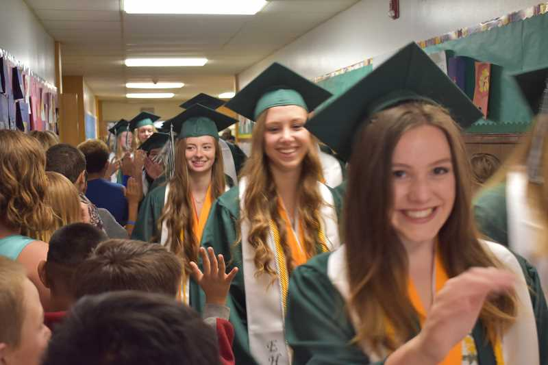 ESTACADA NEWS PHOTO: EMILY LINDSTRAND - Estacada High School graduating seniors are all smiles during the school districts annual grad walk last week.