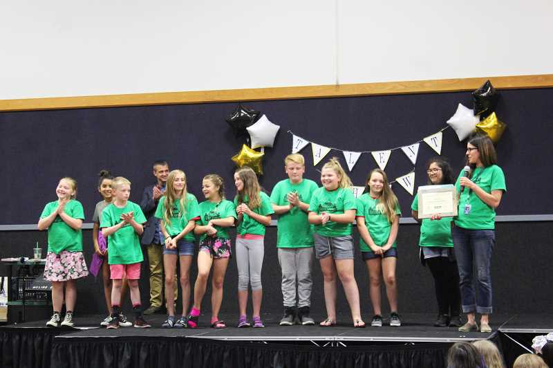 PIONEER PHOTO: KRISTEN WOHLERS - Noelle Veveiros and her elementary school green team celebrated becoming an Oregon Green School on June 1.