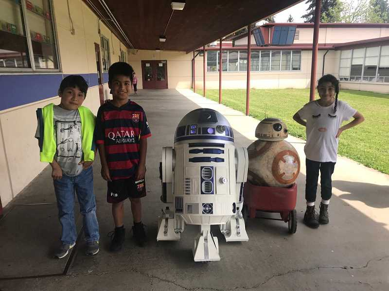 'Star Wars' characters R2-D2 and BB-8 stop by Brookwood Elementary earlier this year. The district is hoping to collect photos of the school before it is rebuilt in 2020.
