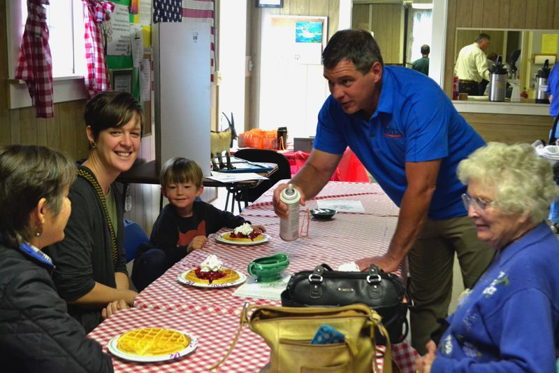 POST PHOTO: BRITTANY ALLEN - Local political incumbents and candidates for (re)election served waffles at the annual Boring-Damascus Grange Strawberry Waffle Breakfast on June 10.