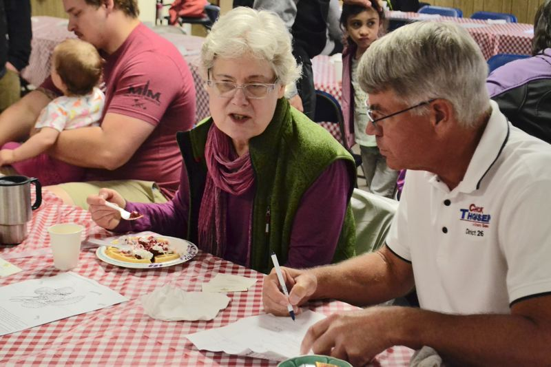 POST PHOTO: BRITTANY ALLEN - Political candidates such as Sen. Chuck Thomsen served waffles and socialized with those who attended the annual Strawberry Waffle Breakfast in Boring.