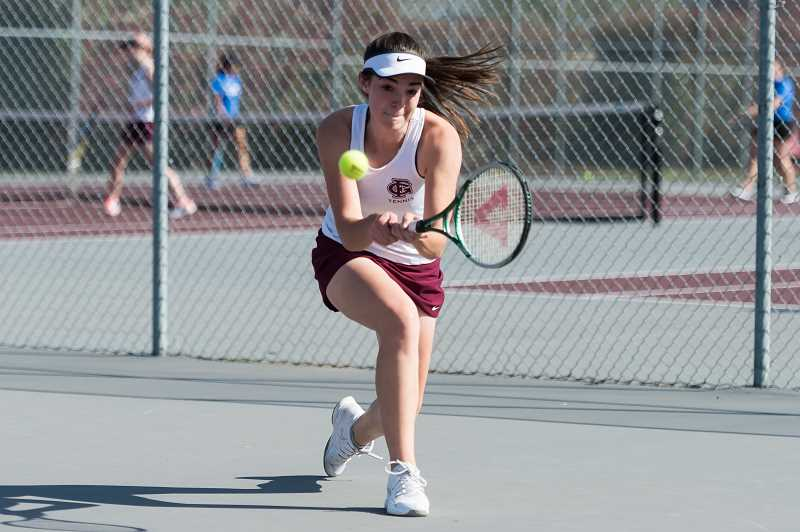 STAFF PHOTO: CHRISTOPHER OERTELL - Forest Grove's Jacqueline Frawley takes a backhand swipe at a ball during a Vikings match last season.