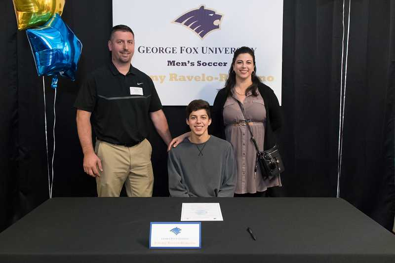 STAFF PHOTO: CHRISTOPHER OERTELL - Glencoe's Jeremy Ravelo-Romano poses for a picture with his parents Scott and Selene during his letter of intent signing last Tuesday, June 5, at Glencoe High School.