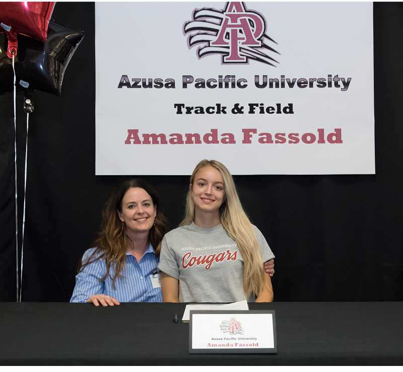 STAFF PHOTO: CHRISTOPHER OERTELL - Amanda Fassold poses for a photo with her mother, Amy Irwin during her letter of intent signing last Tuesday, June 5, at Glencoe High School.