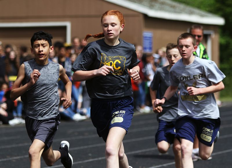 TIMES PHOTO: DAN BROOD - Fowler's Caroline Johnson (center) triumphed in the sixth-grade girls race a the Beadnell Classic mile run.