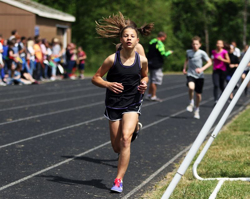 TIMES PHOTO: DAN BROOD - Fowler's Lily Herman triumphed in the seventh-grade girls race.