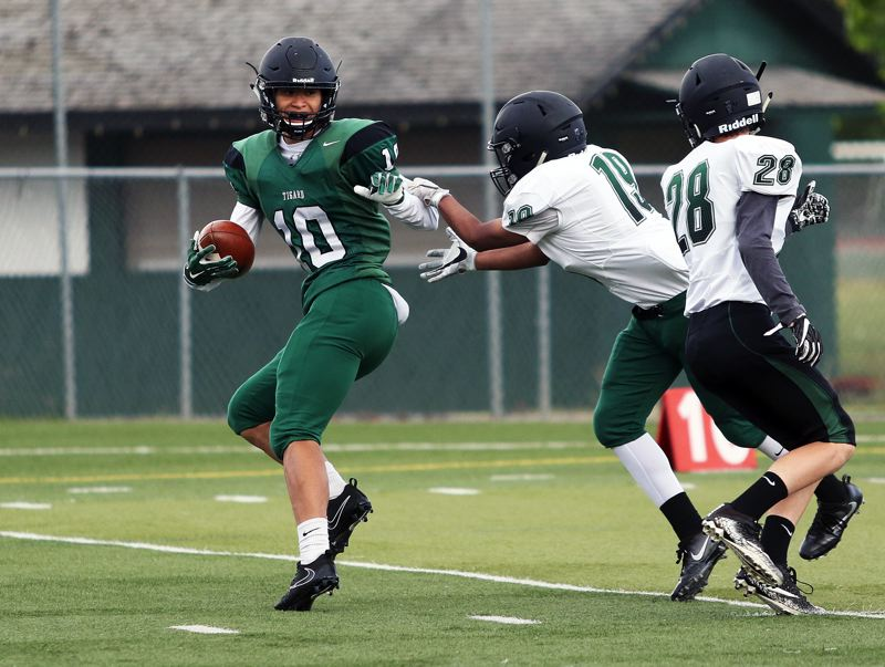TIMES PHOTO: DAN BROOD - Green receiver Jazz Ross (10) looks to make a move after catching a pass in Saturdays Tigard Chicken and Bean Bowl.