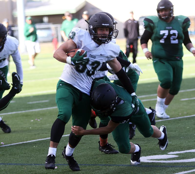 TIMES PHOTO: DAN BROOD - White running back Hunter Gilbert (33) heads up field during play in Saturdays Tigard Chicken and Bean Bowl.