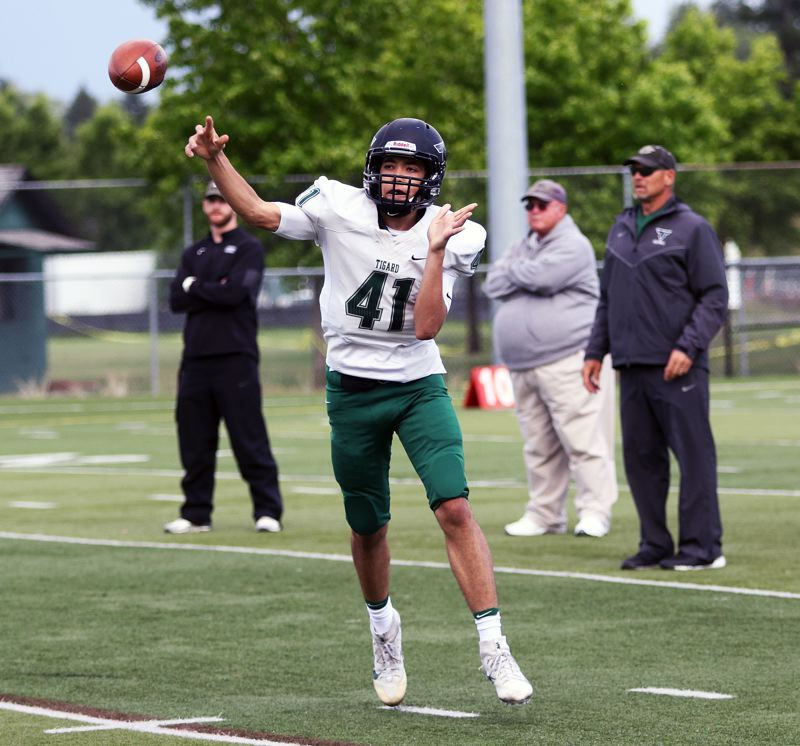 TIMES PHOTO: DAN BROOD - White team quarterback Drew Carter throws a pass during Saturday's Tigard Chicken and Bean Bowl.