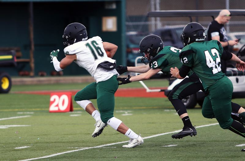 TIMES PHOTO: DAN BROOD - White team receiver Max Lenzy (16) tries to break into the clear during Saturday's Tigard Chicken and Bean Bowl.
