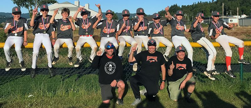 SUBMITTED PHOTO - The Fultano's Pizza team from Scappoose shows everyone who was No. 1 after winning three straight games and the Tournament of Champions title in Rainier.