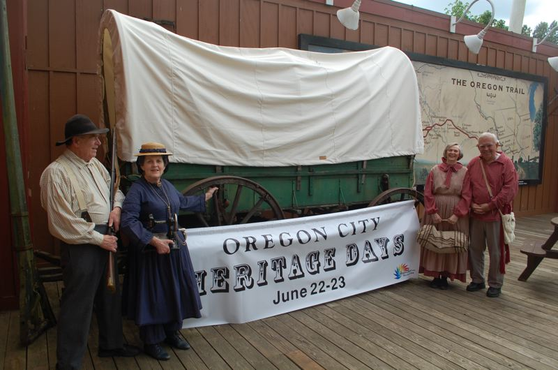 PHOTO BY: RAYMOND RENDLEMAN - From left, Rolla and Marge Harding, along with Lynn and Wendell Baskins, prepare their traveling costumes and wagon for the long trek to the Portland Rose Festival's Oregon City Heritage Days event theyre organizing.