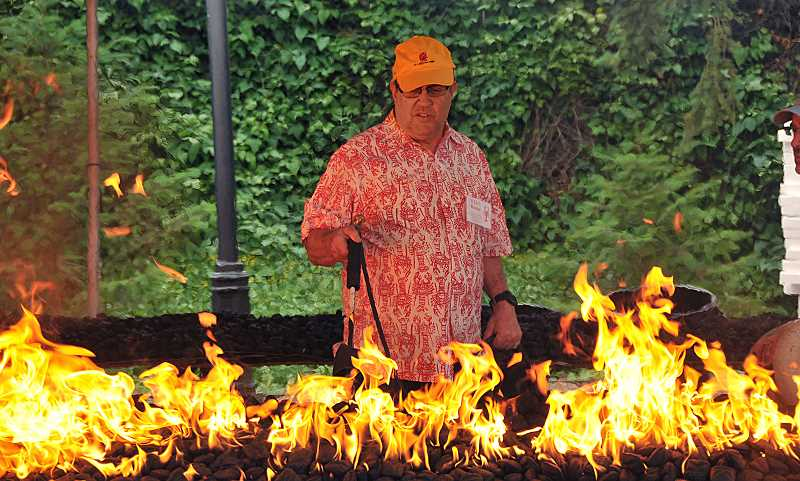 REVIEW PHOTO: VERN UYETAKE - Curt Taylor fires up the grill at the the Lake Oswego Rotary Club's Lobster Feed and Charity Auction in 2017. This year's event is set for Saturday, June 16, at the Lakewood Center for the Arts.