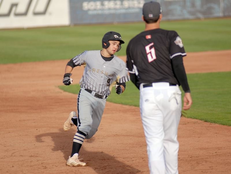 GRESHAM OUTLOOK: MATT RAWLINGS - Cam Vasquez looks to round third base in the GreyWolves 6-1 loss to the Volcanoes.
