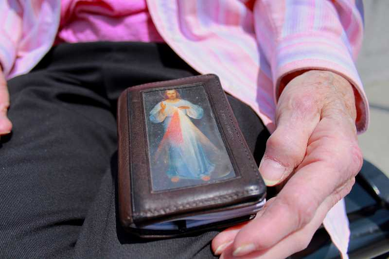 REVIEW PHOTO: SAM STITES - Sister Marilyn carries a small notebook with an image of Jesus Christ on the cover. Inside are lists of names of people she has met who have touched her heart.