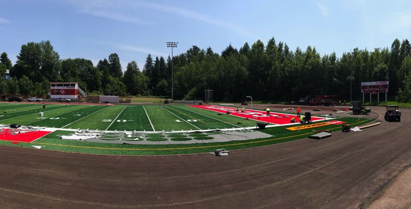PHOTO COURTESY: MICHAEL CLARK - A crew is already hard at work renovating Oregon City High School's athletic facility, with the goal of completing the work in time for August sports practices. The project includes a new all-weather field surface, a new track surface, and an improved sound system and scoreboard.