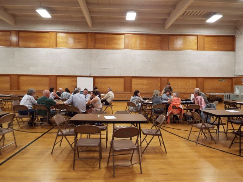 PHOTO BY: MADISON DALLING-RAISNER - Groups of Oak Lodge residents work together to come up with a list of priorities at a recent town-hall meeting.
