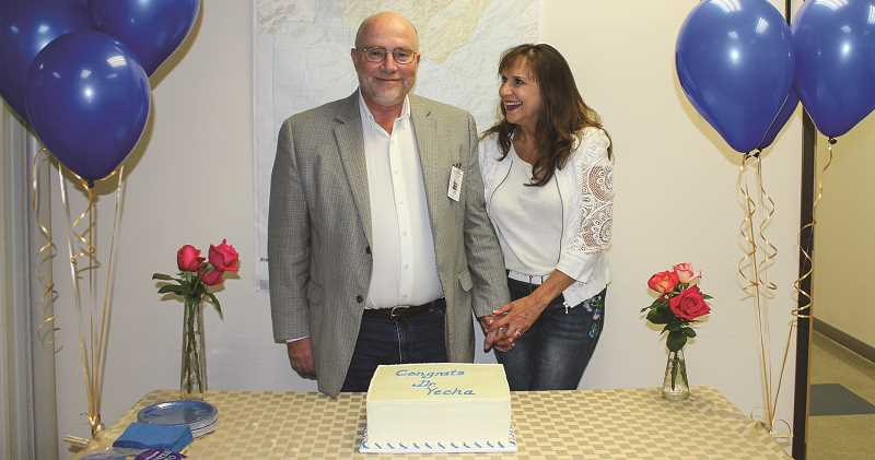 HOLLY SCHOLZ - Crook County School District Director of Business and Finance Anna Logan made a farewell cake for retiring Superintendent Dr. Duane Yecha and shared it with school board members and staff Monday during the monthly board meeting. Pictured are Yecha and his wife, Suzy.