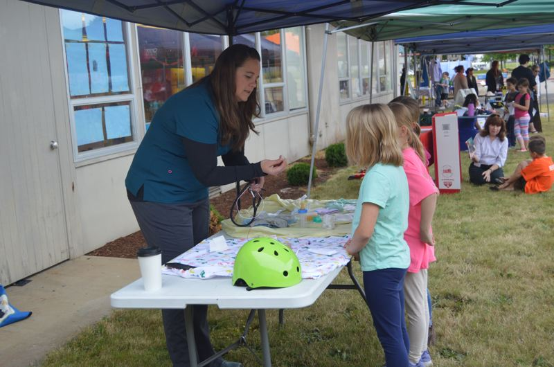 SPOTLIGHT PHOTO: NICOLE THILL-PACHECO - Summer Hoag, a neonatal intensive care unit and pediatric ICU nurse, talks with students about her job and the tools she uses to help treat patients. She also spoke with students about a variety of health topics, like wearing a helmet while riding a bike.