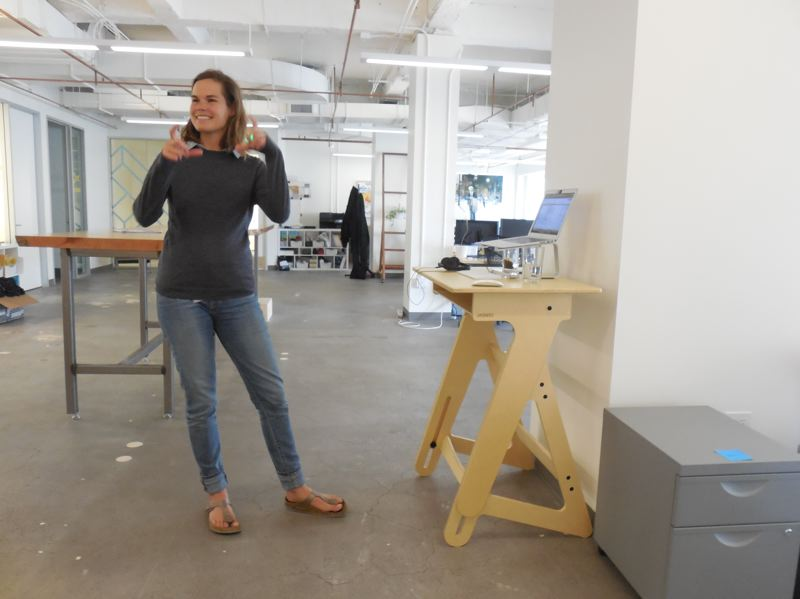 PAMPLIN MEDIA GROUP: JOSEPH GALLIVAN - This XPLANEr designed her own standing desk then mrketed it as a kit on a crowdsourcing platform. The empty desks in the backgorund of the Sixth Avenue HQ are a sign that people can work any hours they want, or remotely, so long as they get the job done, says Wood.