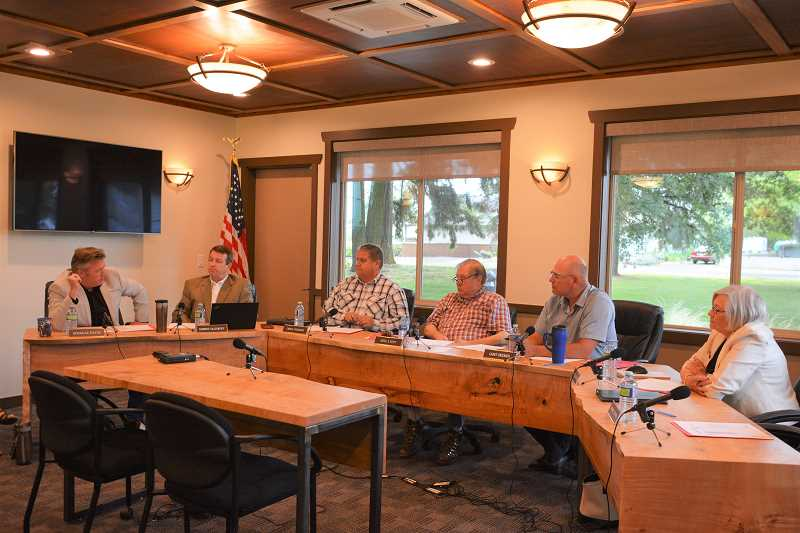SPOTIGHT PHOTO: COURTNEY VAUGHN - Port of St. Helens commissioners listen to comments from Kate Mickelson of the Columbia River Steamship Operators Association during a meeting Wednesday, June 13. Commissioners heard concerns over the ports efforts to change its name.