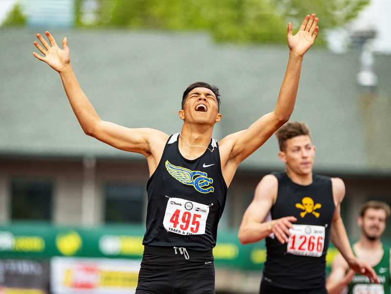 LON AUSTIN/CENTRAL OREGONIAN - Victor Ramirez celebrates after winning a state championship in the 400-meter dash. Ramirez, a senior, also placed third in the 200 and anchored the school's fourth-place 4x100 relay team and the 4x400 relay team, which finished second, setting a school record in the process. Ramirez was one of seven seniors on this year's Crook County track and field team.