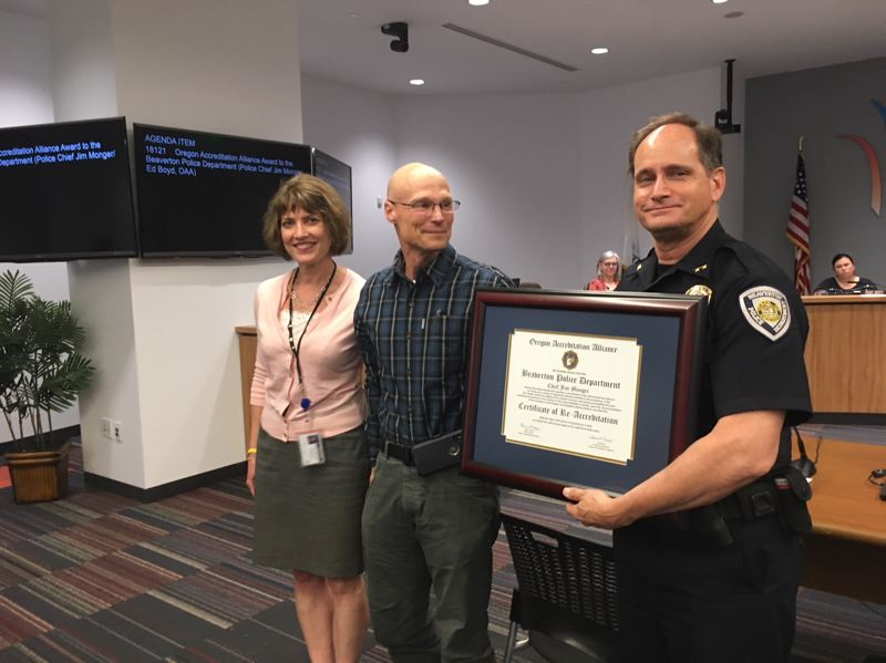 THE TIMES: PETER WONG - Beaverton Police Chief Jim Monger, right, receives the agency's fifth consecutive certificate from the Oregon Accreditation Alliance for meeting numerous professional standards. With him at a City Council meeting June 12 are Michelle Harrold, police management analyst, and Ed Boyd, executive director of the Oregon alliance.