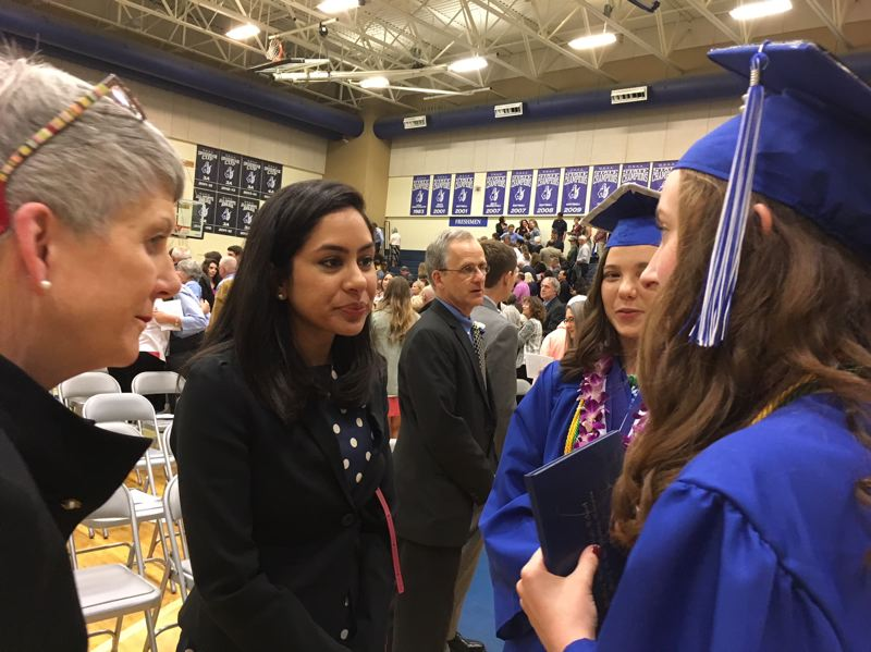 THE TIMES: PETER WONG - Seema Mody, global markets reports for CNBC, speaks with new graduates in the Class of 2018 from Valley Catholic High School in Beaverton. Mody, a 2003 alumna, gave the commencement address June 9. To the left is Kathy Johnson, an English teacher Mody credited as an influence on her life.