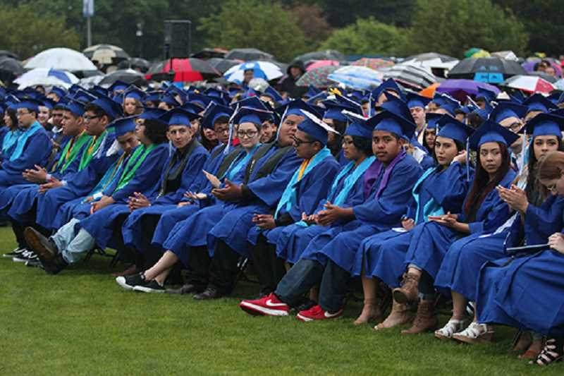PHIL HAWKINS - The Class of 2018 at Woodburn High School sits through the commencement ceremony June 8.