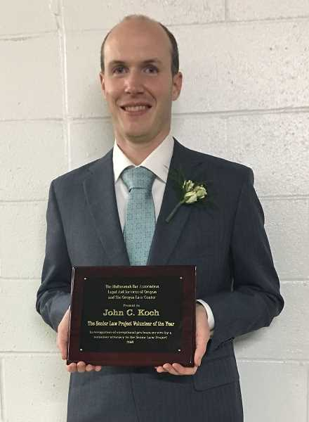 """SUBMITTED PHOTO - Lake Oswego attorney Jon Koch holds his award from the Multnomah Bar Association. """"Being recognized for what you feel is doing the right thing, it makes it feel like the universe is in order,"""" he says."""