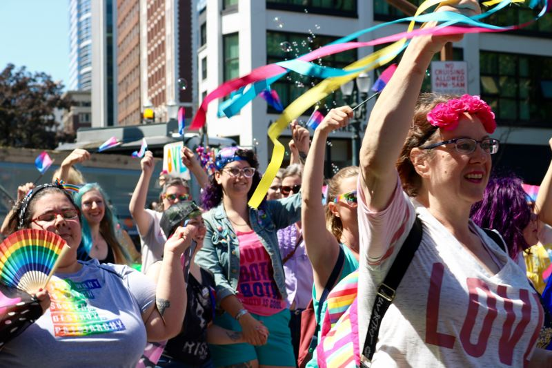 TRIBUNE PHOTO: ZANE SPARLING - Community members smile and wave during the 2018 Pride Parade in downtown Portland on Sunday, June 17.