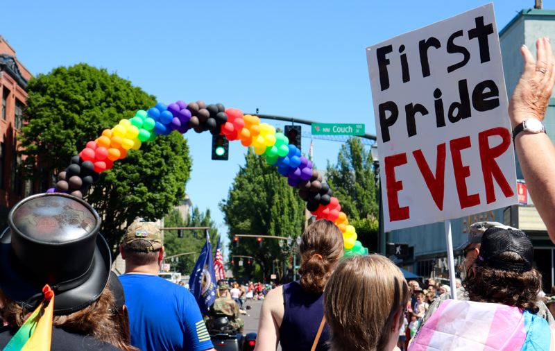TRIBUNE PHOTO: ZANE SPARLING - A person holds a sign reading 'First Pride Ever' during the 2018 Pride Parade in Portland.