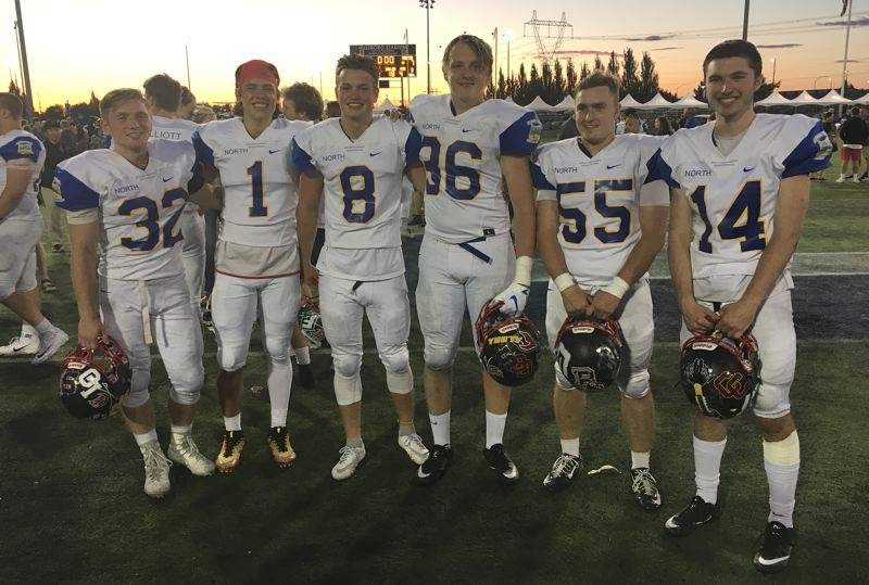 PAMPLIN MEDIA: JIM BESEDA - Clackamas' players (left to right) James Millspaugh, Braelen Bettles, Mitchell Modjeski, Perry Cosgriffe, Hudson Bishop, and Aric Bergers play keys roles in the North 24-7 win Saturday.