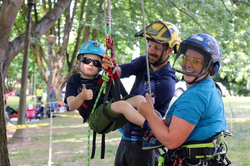 TRIBUNE PHOTO: ZANE SPARLING - The tree climbing competition also featured a non-competitive assisted climb for Portland's littlest arborists.