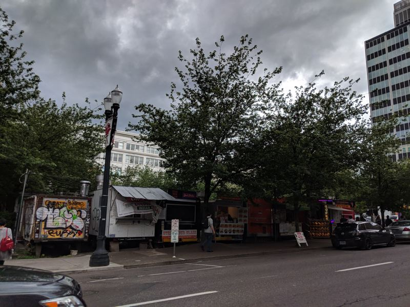 PAMPLIN MEDIA GROUP: JOSEPH GALLIVAN - The Alder Street Food Carts line the edge of the block defined by Southwest 10th and 9th Avenues and Southwest Alder and Washington Streets. A parking lot sits in the middle of the land, which is owned by the Goodman family, whom Bowen says he has known for 25 years.