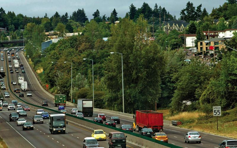 PORTLAND TRIBUNE FILE PHOTO - Planners studied routing much of the proposed MAX line between I-5 and Southwest Barbur Boulevard, up thr hill to the right in this photo. The Intitial Proposed Route recommends putting it on a reconstructed Barbur.