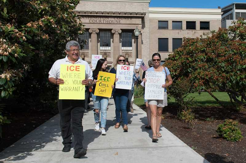 STAFF PHOTO: CHRISTOPHER OERTELL - Protesters march around the Washington County Circuit Court on June 18, protesting against federal immigration policy.